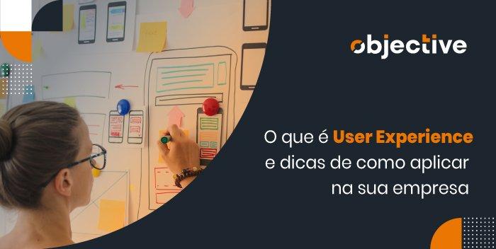 """Pessoa desenhando em papel sobre a parede e a escrita """"O que é User Experience e dicas de como aplicar na sua empresa"""""""