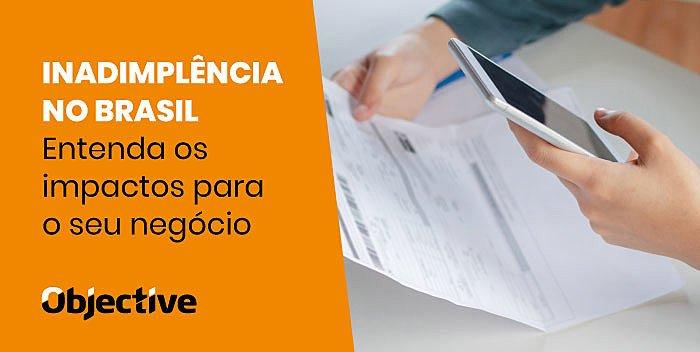 """Imagem de um celular escanceando um boleto e a escrita """"Inadimplência no Brasil: entenda os impactos para o seu negócio"""""""