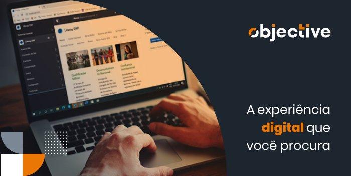 """Um notbook aberto em uma página da web e a escrita """"A experiência digital que você procura"""""""
